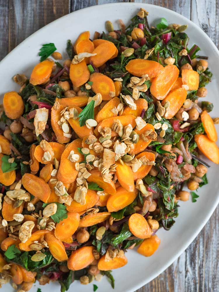 Chickpea Chard Recipe | This Moroccan inspired chickpea chard recipe is served with roasted carrots, labneh and savory granola. Full of flavor, it's the perfect lunch or side dish. | SeasonedVegetable.com #vegan #vegetarian #dinner #recipe