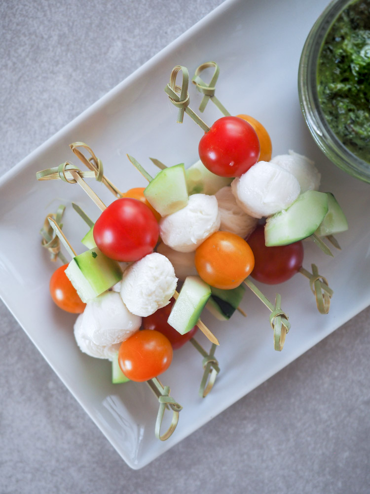Caprese Skewers with Thai Basil Pesto | Caprese skewers are easy and delicious. Paired with a simple thai basil pesto dip for the perfect summer time snack! | SeasonedVegetable.com