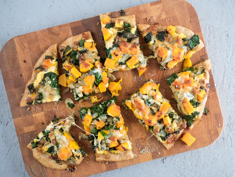 Butternut Squash Pizza   A seasonal butternut squash pizza is perfect for fall. With sage and crispy kale, this homemade pizza is an excellent vegetarian option.   SeasonedVegetable.com #fall #vegetarian #pizza