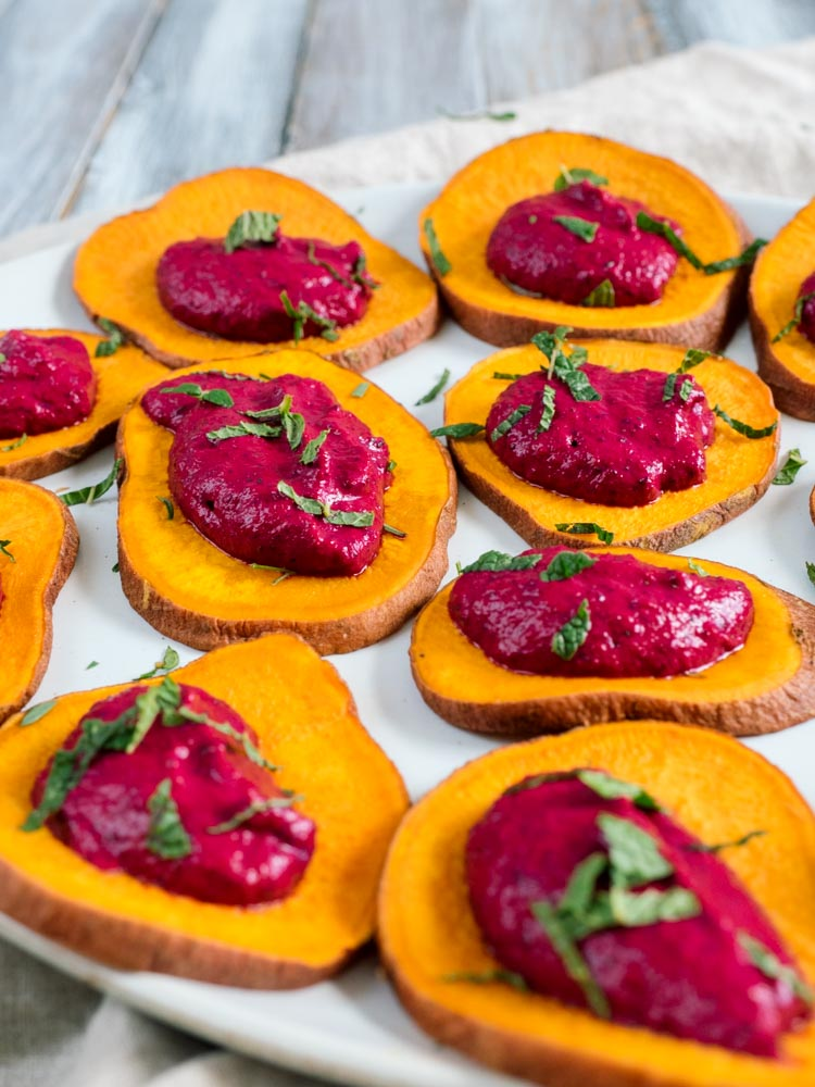 Mint Yogurt Beet Dip | A bright and colorful beet dip recipe with refreshing mint and greek yogurt. Served with roasted sweet potato planks for an easy gluten free appetizer. | SeasonedVegetable.com #beetdip #appetizer #beetyogurtdip #glutenfree #vegetarianrecipe