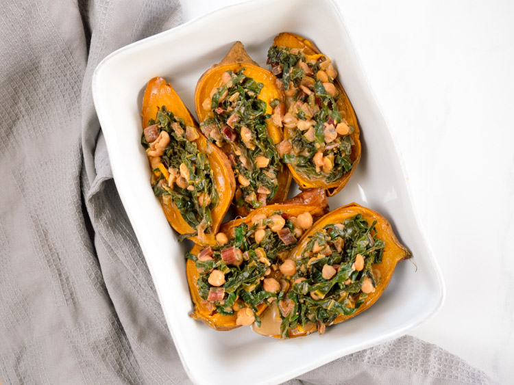 Chickpea Loaded Sweet Potato with Coconut Greens | Coconut greens and chickpea loaded sweet potatoes are the perfect winter meal. Filling, cozy, vegan and gluten free, they're packed with flavor and ready in less than an hour. | SeasonedVegetable.com #veganrecipe #savorysweetpotato #coconutmilk #glutenfreedinner #winterrecipe #vegetarianrecipe