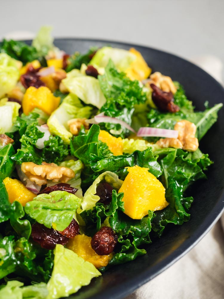 Roasted Acorn Squash Kale Salad   A roasted acorn squash kale salad with an orange vinaigrette dressing is perfect for winter lunch or dinner. Vegan, gluten free, paleo and Whole30 friendly.   SeasonedVegetable.com #wintersalad #veganrecipe #glutenfreerecipe #winterrecipe #vegetarianrecipe #vegetariansalad