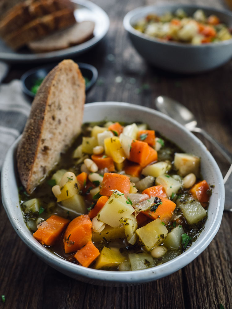 White Bean Root Vegetable Soup   This root vegetable soup with white beans brings together humble ingredients for an easy, flavorful and hearty soup. Perfect for cold winter nights.   SeasonedVegetable.com #soup #vegetarianrecipe #souprecipe #rootvegetables